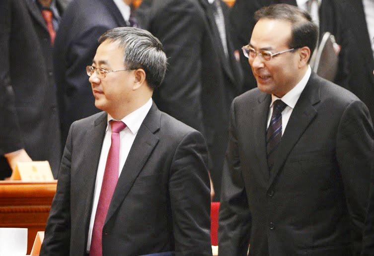 Hai ông Hồ Xuân Hoa (đi trước) và Tôn Chính Tài tại Hội nghị chính trị hiệp thương nhân dân Trung Quốc hồi tháng 3/2016. (Ảnh: Aboluowang)