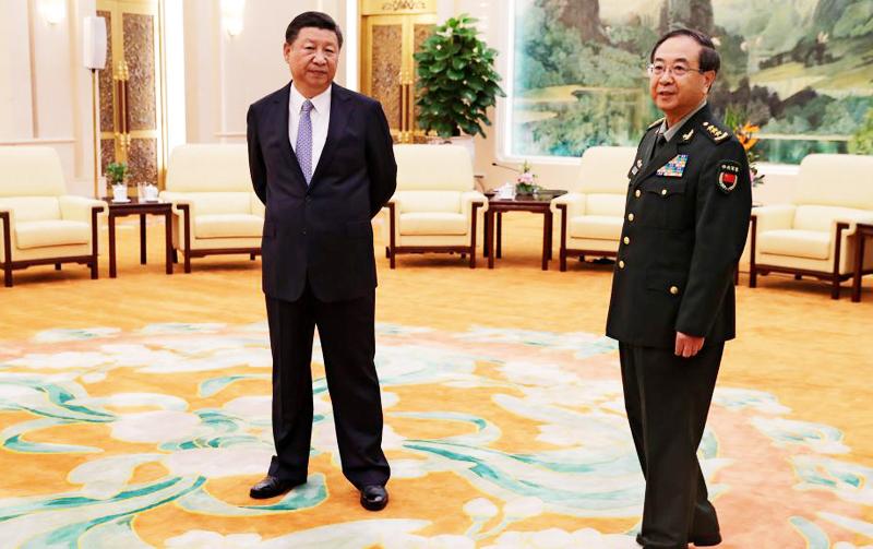 Thượng tướng Phòng Phong Huy và ông Tập Cận Bình. (Ảnh: )