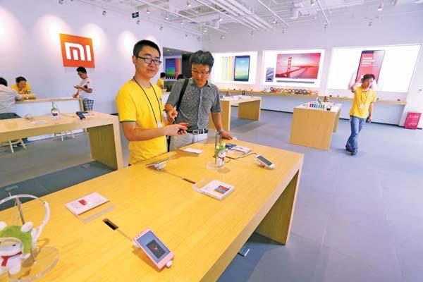 Thứ mà Xiaomi cần sao chép là mô hình kinh doanh và các cửa hàng giống Apple Store. (Ảnh: Internet)