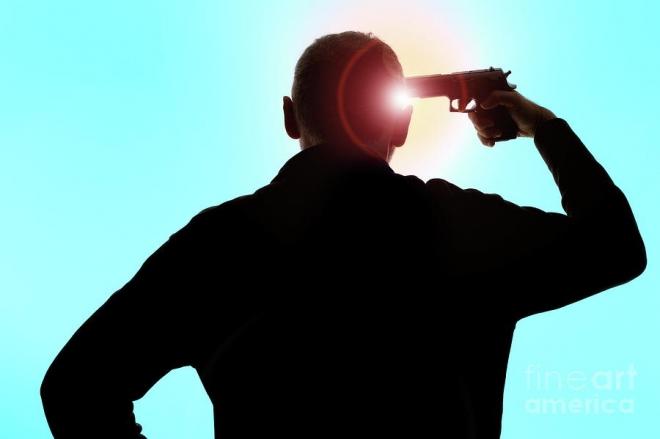 man-pointing-gun-on-head-sami-sarkis-660x439