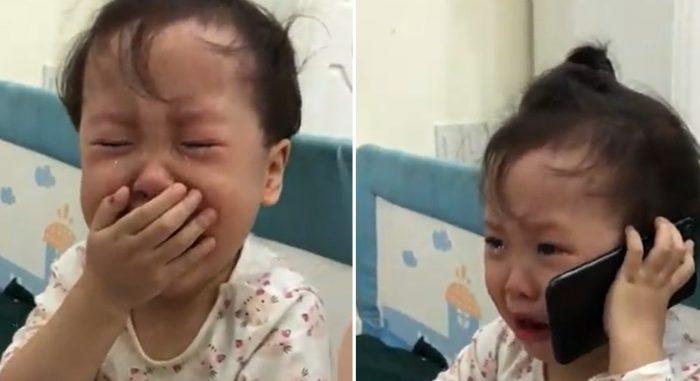 Chịu không nổi bố nữa, bé gái gọi điện mách ông nội trong nước mắt.1