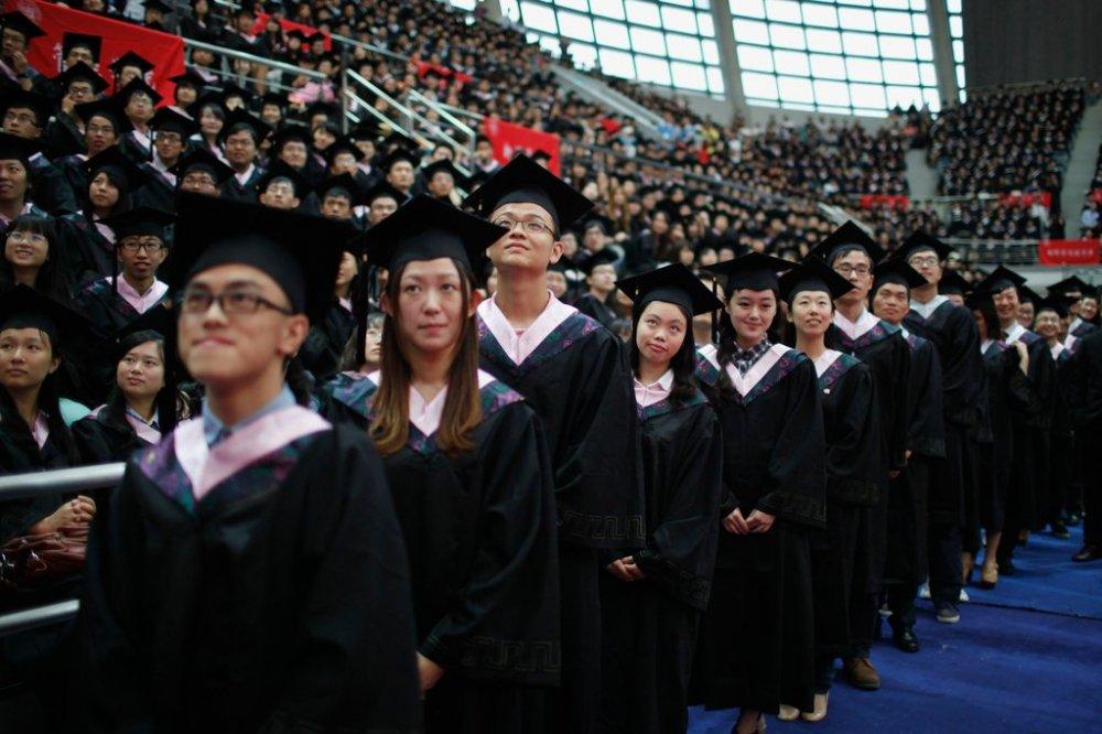 Một số trường học Trung Quốc có thể từ chối sinh viên ghi danh nếu bố mẹ của họ có điểm tín nhiệm xã hội thấp. (Ảnh: Reuters)