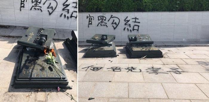 Bia mộ cha mẹ ông Hà bị đập phá. (Ảnh qua hongkongfp.com)