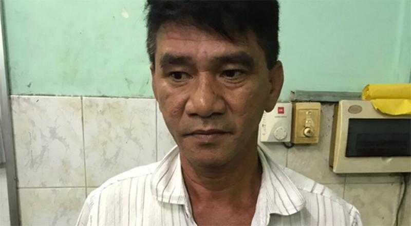 Người đạp xích lô tên Phạm Văn Dũng tại cơ quan công an.