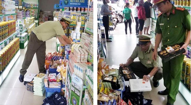 Đoàn kiểm tra Cục QLTT tỉnh Bình Phước cùng Cảnh sát môi trường Công an tỉnh kiểm tra các cơ sở bán hàng nhập lậu, không rõ nguồn gốc xuất xứ. (Ảnh qua thanhnien)