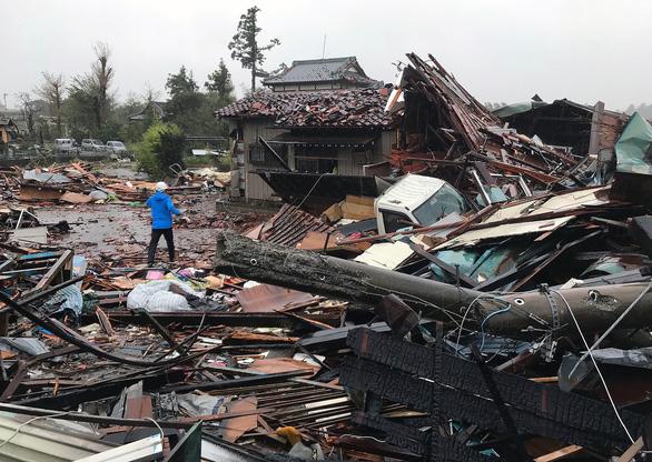 Nhà cửa của người dân ở thành phố Ichihara, tỉnh Chiba bị siêu bão Hagibis tàn phá trong ngày 12-10 - Ảnh: AFP