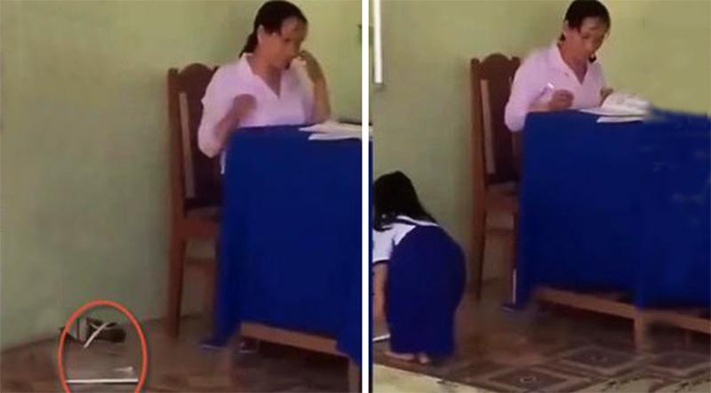 Vở của học sinh bị cô Tư ném xuống bục giảng. (Ảnh qua laodong)