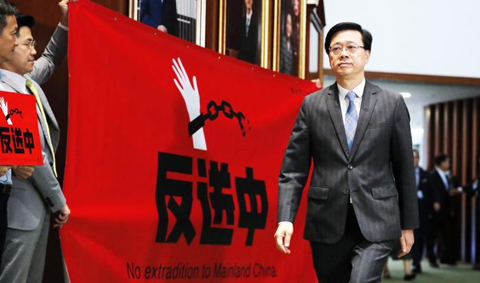 """Ngày 23/10, Cục trưởng Cục An ninh Hồng Kông Lý Gia Siêu đã chính thức tuyên bố thu hồi lại dự thảo """"Luật Dẫn độ""""."""