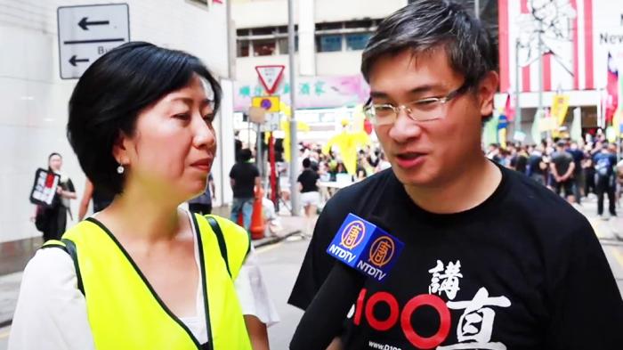 """Tang Phổ, một nhà bình luận chính trị, luật sư, tiến sĩ luật đã xuất hiện tại cuộc biểu tình phản đối """"Luật cấm che mặt"""" vào hôm 13/10."""