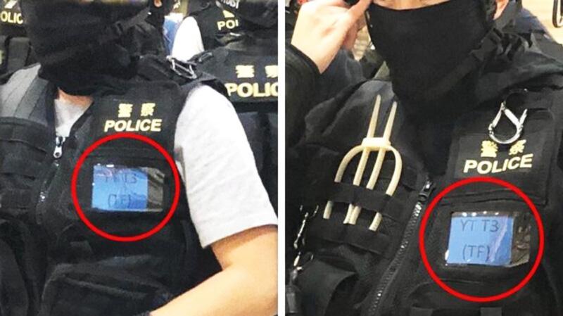 """Hai nhân viên cảnh sát trong cùng một đội có mã trên """"thẻ nhận dạng"""" dán trước ngực hoàn toàn giống nhau."""