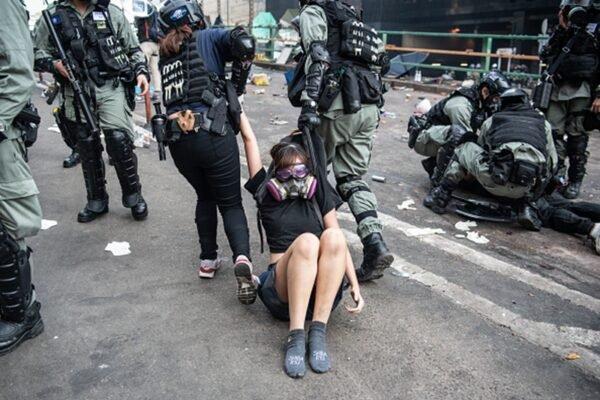 """Tại sao các cô gái trẻ Hồng Kông lại bị ép trở thành phái """"Dũng Vũ""""? (ảnh 2)"""