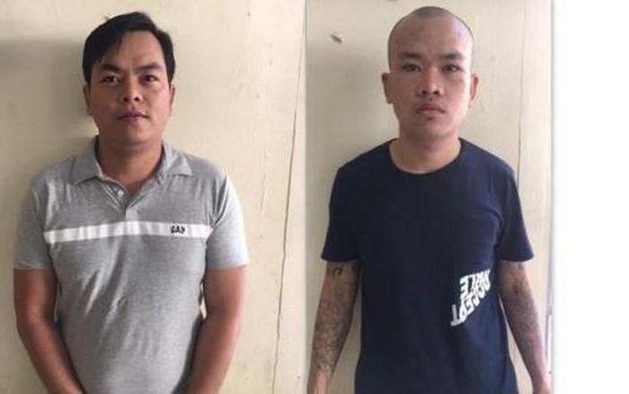 Trần Ngọc Phúc (trái) và em trai Trần Ngọc Tài (phải) tại cơ quan điều tra (Ảnh qua baodatviet).