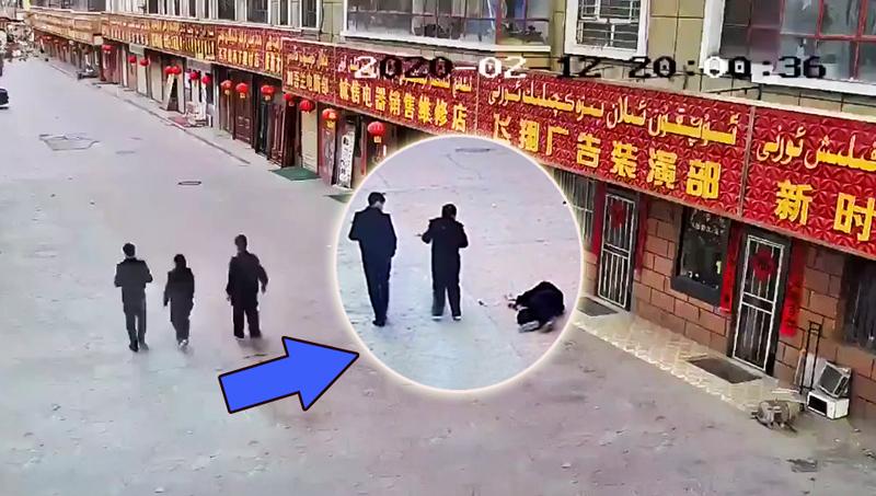 Video giám sát cho thấy công an phòng chống dịch ở Tân Cương đột nhiên ngã quỵ xuống đất.