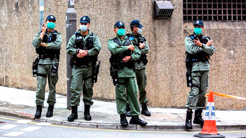Cảnh sát chống bạo động HK bị nhiễm viêm phổi Vũ Hán, 59 người phải cách ly (ảnh 1)
