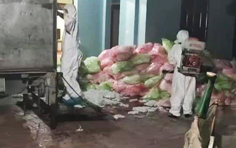 Ngồi nhà cất giấu 620 kg khẩu trang y tế đã qua sử dụng. (Ảnh qua tuoitre)