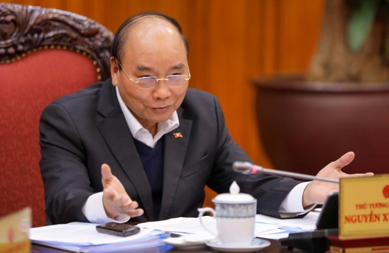Thủ tướng Nguyễn Xuân Phúc khẳng định chưa thể chốt việc cho học sinh đi học lại vào ngày 2/3. (Ảnh qua tuoitre)