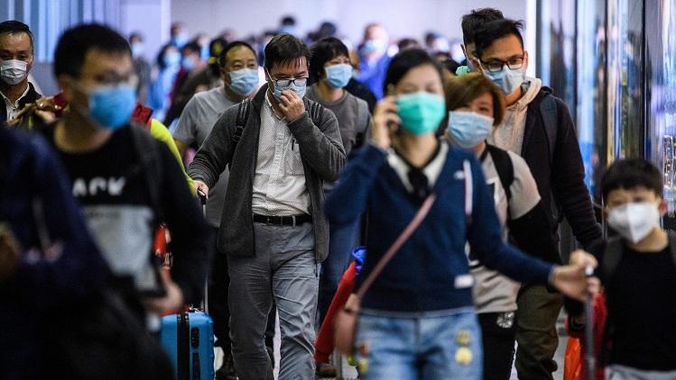 Virua corona bùng phát ở Trung Quốc và cũng khiến cho thị trường kinh tế toàn cầu chịu ảnh hưởng liên đới. (Ảnh qua AFP