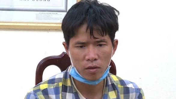 Nguyễn Văn Quýnh tại cơ quan công an. (Ảnh qua tuoitre)