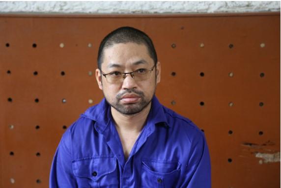 Đối tượng Wu Yong Jiang tại cơ quan điều tra. (Ảnh qua nld)