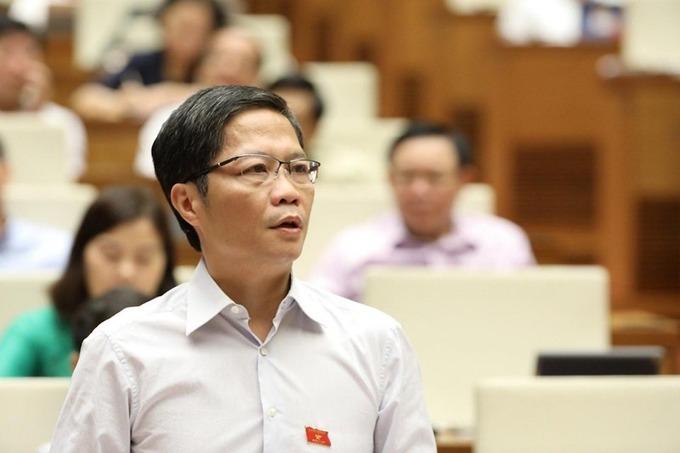 Bộ trưởng Trần Tuấn Anh giải trình trước Quốc hội tại phiên thảo luận kinh tế xã hội ngày 15/6. (Ảnh qua vnexpress)