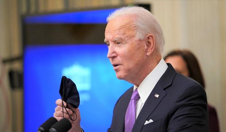 Tổng thống Joe Biden phát biểu về phản ứng Covid-19 trước khi ký lệnh hành pháp trong Phòng ăn của Nhà Trắng ở Washington, DC, vào ngày 21/1/2021